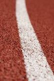 White line on tartan. At athletic stadium Royalty Free Stock Images