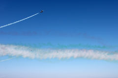 White line of track of airplane on blue sky background, horizontal view. Stock Photo