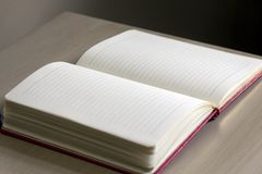 White Lined Notebook on Gray Table Stock Photo