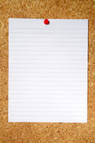 White lined paper. White lined paper pinned to a cork notice board Stock Image
