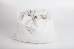 White linen bag with a rope on a light background Royalty Free Stock Photo