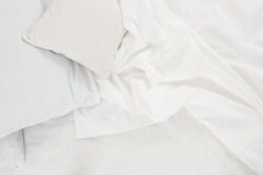 White linen cloth. New snow-white bed, pillows and crumpled sheets, white linen cloth, white abstract background Stock Photography