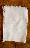 White Linen Light on the old board. White Linen Light Fabric on the old board Royalty Free Stock Images