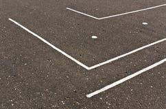 White lines on asphalt surface. Royalty Free Stock Image
