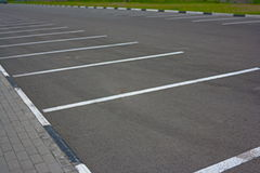White lines of marking on a background of gray asphalt parking Stock Photo