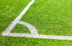White lines marking on green grass in the corner Stock Photography