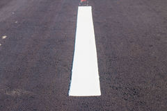White lines on newly refurbished. Paved roads royalty free stock photo