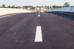 White lines on newly refurbished. Paved roads royalty free stock photography