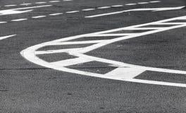 White lines over dark gray asphalt, road marking Stock Photos