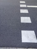 White lines over gray asphalt, road marking Royalty Free Stock Photo
