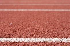 White lines on tartan. At athletic stadium Stock Photos