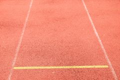 White lines and texture of running racetrack, red rubber racetracks in small stadium Stock Image