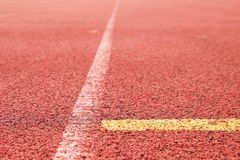 White lines and texture of running racetrack, red rubber racetracks in small stadium Stock Photo