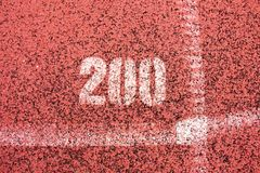 White lines and texture of running racetrack, red rubber racetracks in small stadium Royalty Free Stock Images
