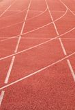 White lines and texture of running racetrack, red rubber racetracks in small stadium Stock Photography