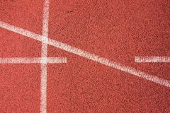 White lines and texture of running racetrack, red rubber racetracks in small stadium Royalty Free Stock Photos