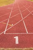 White lines and texture of running racetrack, red rubber racetracks in small stadium Stock Images