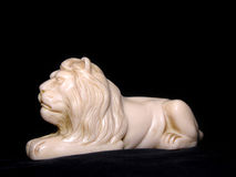 White Lion Sculpture. A white lion sculpture, isolated on black studio background stock photography