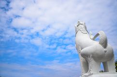 White lion statue and blue sky Stock Images
