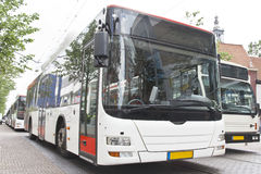 White Liquefied Petroleum Gas Buses. Enivrement Friendly White LPG bus in front the Spui or the City Hall of The Hague, Netherlands Stock Photo
