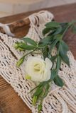 White lisianthus placed on macrame wall art. Shot with shallow depth of field Royalty Free Stock Photo