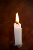 White lit candle Stock Images