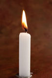 White lit candle Stock Photos