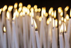 White lit candles. In religious shrine, symbolism stock photo