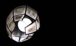 Capiz lantern. A white lit capiz lantern hanging by the trellis covered pathwalk Stock Images