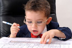 white little boy studying papers in office Royalty Free Stock Photo