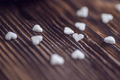 White little hearts on wooden table, valentines or wedding day Stock Photo