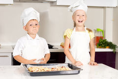 White Little Kids in Chefs Attire Made Pizza Royalty Free Stock Photography