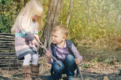 White Little Kids Fighting for Dried Stick Stock Image