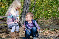 White Little Kids Fighting for Dried Stick Royalty Free Stock Photography