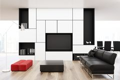 White living room with a black sofa, red Royalty Free Stock Image