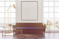 White living room, blue sofa, poster toned. White living room interior with a wooden floor, loft windows, a blue sofa, a coffee table and a framed vertical Royalty Free Stock Image