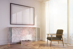 White living room, fireplace, black armchair toned. Side view of a white living room interior with a marble fireplace, a black armchair, a framed horizontal Stock Photography