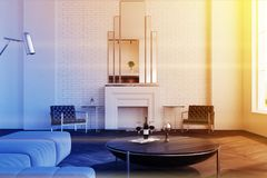 White living room, fireplace, toned. White brick living room interior with a wooden floor, large windows, a fireplace and a sofa near a round coffee table. 3d Royalty Free Stock Images