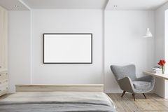 White living room with a gray armchair, poster. White living room interior with a wooden floor, and a gray armchair near a narrow table. A horizontal poster 3d Stock Image