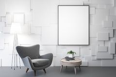 White living room, gray armchair, poster, table. White living room interior with a gray armchair with a framed vertical poster hanging above it. A round coffee Stock Images