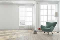 White living room with a green armchair. Empty white living room interior with a wooden floor, tall windows and a green armchair near a stack of books. 3d Royalty Free Stock Photos
