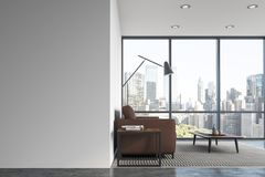 White living room interior, brown sofa. White living room interior with a concrete floor, a panoramic window, and a brown sofa near a coffee table. 3d rendering Stock Photos