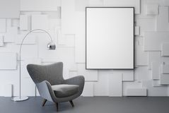 White living room, gray armchair, poster. White living room interior with a gray armchair with a framed vertical poster hanging above it. 3d rendering mock up Stock Images