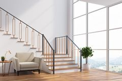 White living room interior, stairs, armchair, side Stock Images