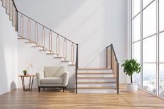 White living room interior, stairs, armchair Royalty Free Stock Images