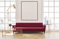 White living room, red sofa, poster. White living room interior with a wooden floor, loft windows, a red sofa, a coffee table and a framed vertical poster on a Stock Photography