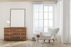 White living room with an armchair, poster. White living room interior with a wooden floor, a tall window and a white armchair near a dresser with a poster on it Royalty Free Stock Image