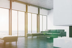 White living room with a sofa, corner toned Royalty Free Stock Images
