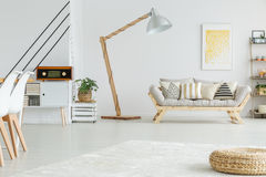 White living room. Spacious white living room with geometric pattern on the wall Royalty Free Stock Photography