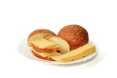 White loaf and cheese. From a white loaf and cheese the tasty sandwich by a breakfast turns out Stock Image